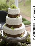 wedding cake and bouquets on... | Shutterstock . vector #38981275