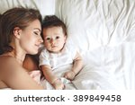 portrait of beautiful mom... | Shutterstock . vector #389849458