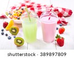 two glasses of fruit juice on a ... | Shutterstock . vector #389897809