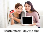 Woman Online Shopping With...