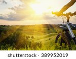 lady with bicycle on a rural... | Shutterstock . vector #389952019