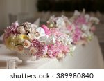 table setting at a luxury... | Shutterstock . vector #389980840