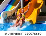 kids play on water slide at... | Shutterstock . vector #390076660