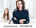 manager with her team working... | Shutterstock . vector #390088558