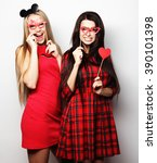 girls best friends wearing red ... | Shutterstock . vector #390101398