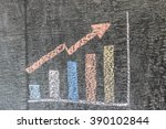 Small photo of Business chart on blackboard showing increase in sales