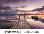 pier with fishing vessels at... | Shutterstock . vector #390103108