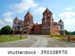 Small photo of The ancient castle with towers, acute-angled roof./The fortress from red capstone./ MIR, BELARUS, EAST EUROPE - JULY 1, 2015: From UNESCO heritage. Mir Castle. East Europe. Belarus