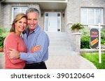 happy senior couple near new... | Shutterstock . vector #390120604