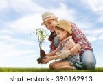 mom and her child girl plant... | Shutterstock . vector #390162913