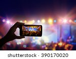 hand with a smartphone records... | Shutterstock . vector #390170020