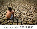 Sad A Boy Sitting On Dry Groun...