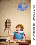 child astronaut with cardboard... | Shutterstock . vector #390181708