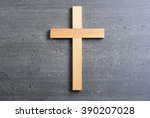 wooden cross on old black wood... | Shutterstock . vector #390207028