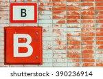 Peeled Brick Wall With B Sign.