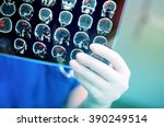 Stock photo doctor attentively examines the mri scan of the patient 390249514