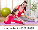 mother and daughter doing... | Shutterstock . vector #390258934