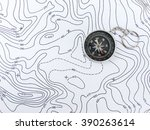 compass on topographic map. | Shutterstock . vector #390263614