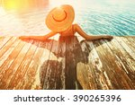 woman in hat relaxing at the... | Shutterstock . vector #390265396