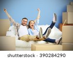 happy young couple moving in... | Shutterstock . vector #390284290