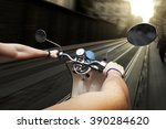 man driving on scooter at old... | Shutterstock . vector #390284620