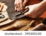 man working with leather using... | Shutterstock . vector #390300130
