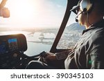 Male Pilot In Cockpit Of A...