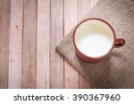 milk in vintage cup from above... | Shutterstock . vector #390367960
