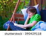 Happy School Boy Reading A Boo...