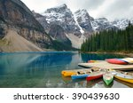 moraine lake and boat with snow ... | Shutterstock . vector #390439630