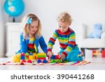children playing with wooden... | Shutterstock . vector #390441268