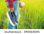 hand holding shoes in hand on... | Shutterstock . vector #390464044