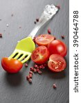red fresh tomatoes on chopping...   Shutterstock . vector #390464788