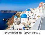oia village on santorini island ... | Shutterstock . vector #390465418