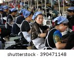 female labors work in a cloth... | Shutterstock . vector #390471148