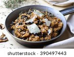 mushroom risotto on vintage pan  | Shutterstock . vector #390497443