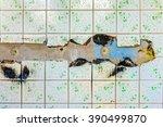 old textured white broken tiles ... | Shutterstock . vector #390499870
