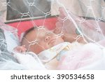 baby sleeping under a mosquito... | Shutterstock . vector #390534658