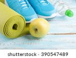 yoga mat  sport shoes  apple ... | Shutterstock . vector #390547489