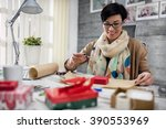 smiling designer packing gift... | Shutterstock . vector #390553969