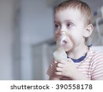 Small photo of child holds a mask vapor inhaler. treatment of asthma. breathing through a steam nebulizer. concept of inhalation therapy apparatus. copy space for your text
