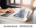 young adult using laptop | Shutterstock . vector #390563218