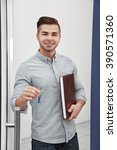 friendly male estate agent on... | Shutterstock . vector #390571360