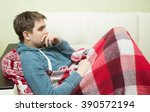 sick man lying on sofa  at home ... | Shutterstock . vector #390572194