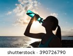female drinking water on a hot... | Shutterstock . vector #390726790