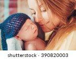 mother and her newborn cute baby | Shutterstock . vector #390820003