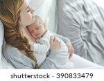 happy mother with newborn baby   Shutterstock . vector #390833479