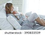 happy mother with newborn baby | Shutterstock . vector #390833539