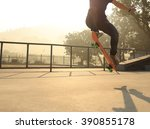 skateboarding woman at sunrise... | Shutterstock . vector #390855178