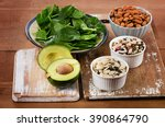 magnesium rich foods on a... | Shutterstock . vector #390864790